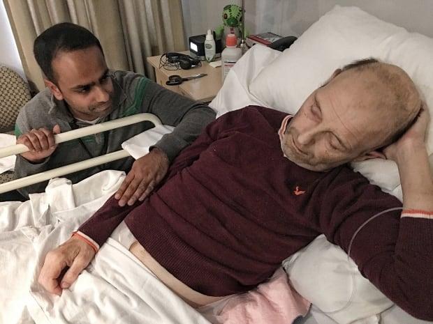 Dr. Naheed Dosani and homeless man