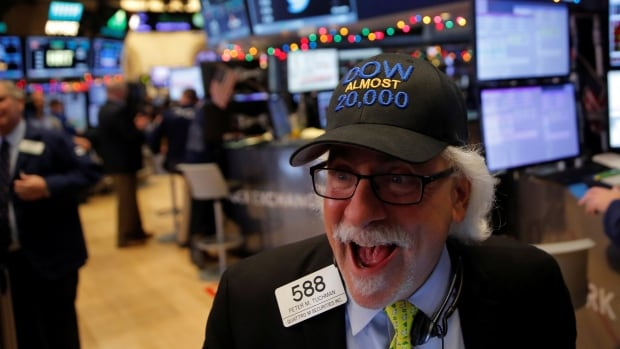 Trader Peter Tuchman, on the floor of the New York Stock Exchange (NYSE), wears a cap in anticipation of the Dow Jones Industrial Average reaching the 20,000-point mark.