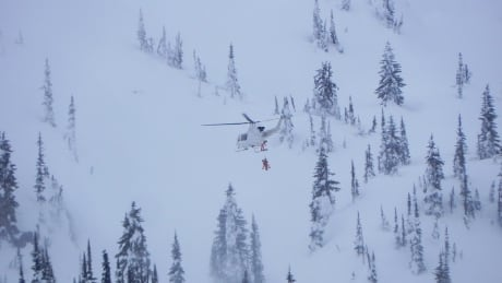 Snowmobilers rescued from dangerous avalanche terrain