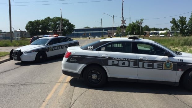 Police block streets in St. Boniface following a chase on July 24 that ended with a suspect being shot.
