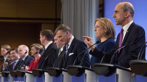 Leadership candidate Steven Blaney, right, speaks during the Conservative Party's French-language leadership debate Tuesday night in Quebec City. Lisa Raitt, next to Blaney, looks on.