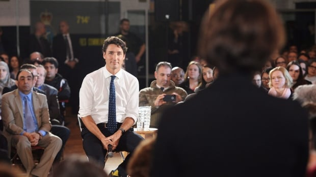 Prime Minister Justin Trudeau listens to a question during a town hall in Sherbrooke, Que.