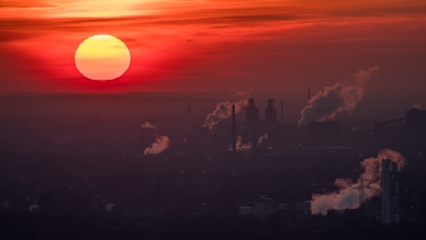 Steam and exhaust rise from different companies on January 6, 2017 in Oberhausen, Germany. World temperatures hit a record high for the third year in a row in 2016, U.S. government agencies said on Wednesday. Greenhouse gases are among the chief causes of global warming and climate change.