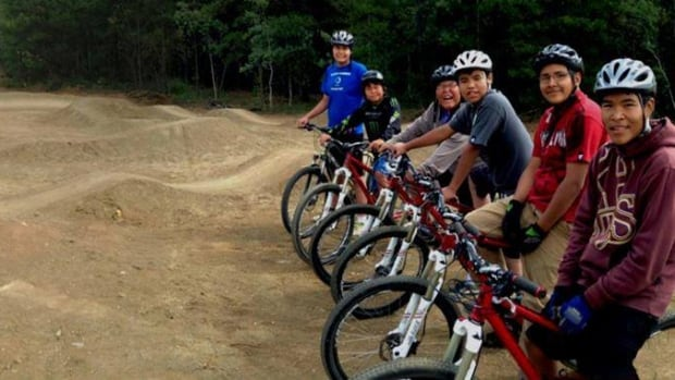 Kids from Boothroyd, B.C. get ready to test out their new mountain bike park.