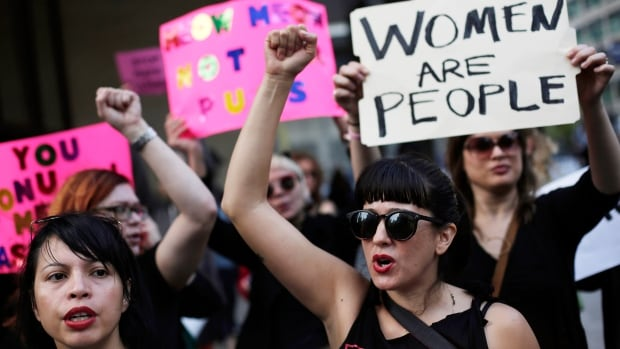 Women take part in a protest against Donald Trump in Chicago. The Women's March on Washington on Saturday is expected to draw as many as 200,000 people, with the stated goal of bringing attention to women's and human rights issues.