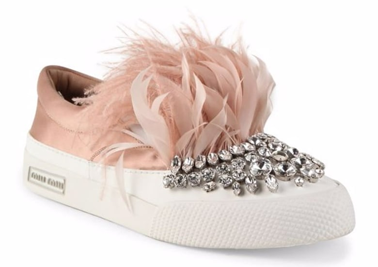 b9a8a8afbbcefb Velvet sneakers get kicked up another notch when adorned with huge pom poms  like this pair by Sam Edelman (on sale for  54) or the Arian genuine fox  fur ...