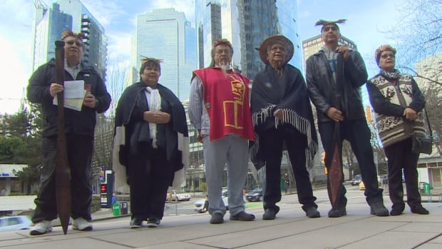 Members of the Nuchatlaht First Nation gather on the steps of the B.C. Supreme Court on Friday, Jan. 20, 2017, after filing a land title case.