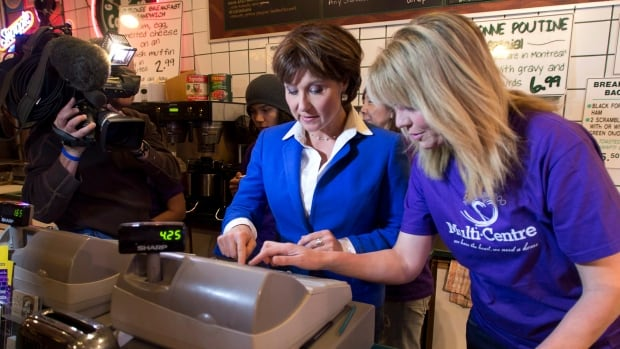 B.C. Liberal leader Christy Clark works the cash register as she makes a campaign stop at a coffee shop in Quesnel, B.C. during the 2013 election. In 2016, her party brought in almost $8M in corporate donations.