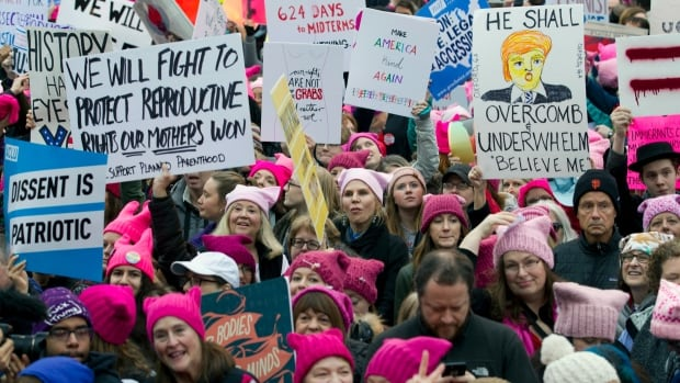 Women begin to gather early and are set to make their voices heard on the first full day of Donald Trump's presidency, Saturday, Jan. 21, 2017 in Washington.