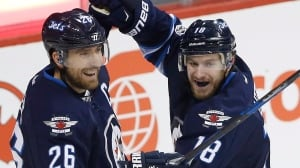 Jets take flight in 3rd to sink Blues