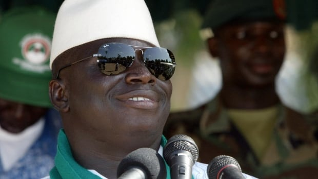 Gambia's former president Yahya Jammeh, seen here in September 2006, has gone into exile, and he's taken millions in government funds and luxury goods with him.