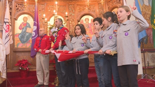 New scouts take the oath during a ceremony at Saints Peter and Paul Melkite Catholic Church Sunday.
