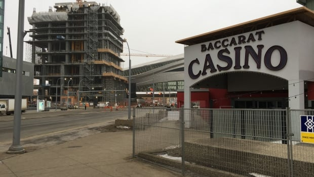 The Baccarat Casino is closed and surrounded by a fence in the middle of Edmonton's Ice District development.
