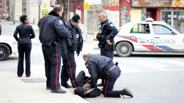 Police officers used a stun gun twice to restrain a man accused of assaulting a female police officer in downtown Toronto on Tuesday. A criminal lawyer says the man who captured video of the incident was performing a civic duty.