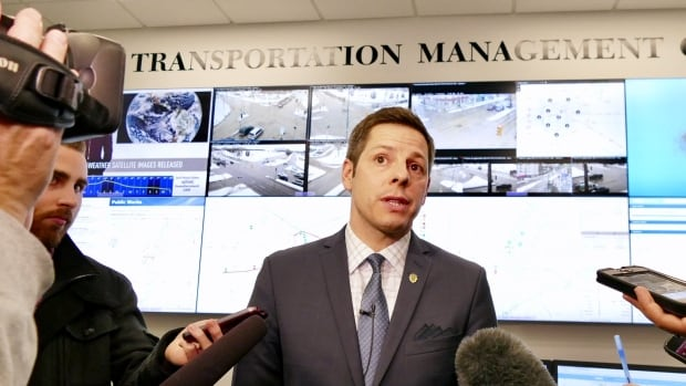 Winnipeg Mayor Brian Bowman speaks with reporters at the unveiling of the city's new transportation hub.