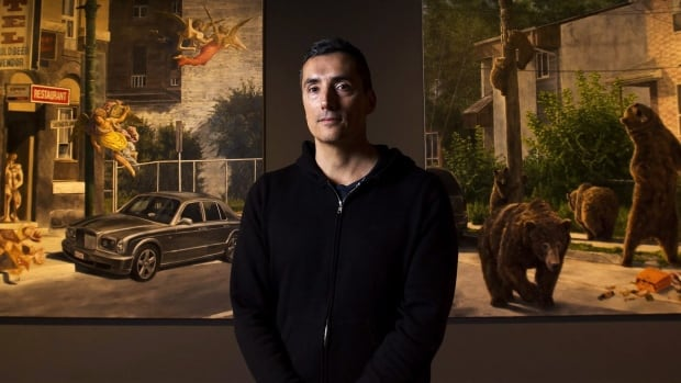 Cree artist Kent Monkman poses for a photograph at his new exhibition Shame and Prejudice: A Story of Resilience.
