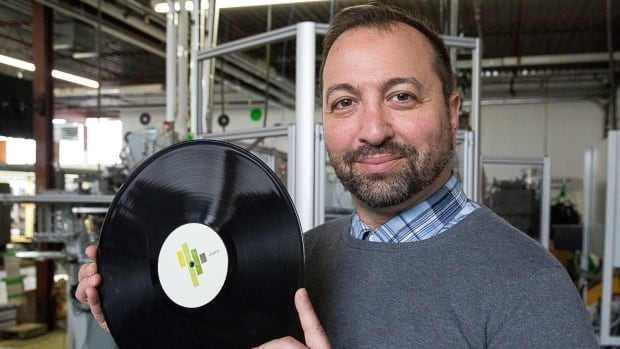 Noble Musa with one of the vinyl records his company Microforum is starting to manufacture.