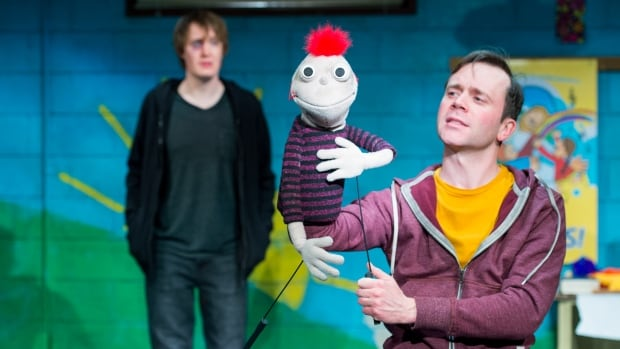 Toby Hughes and Tom Keenan (along with Tyrone the puppet) in the Royal MTC's production of Hand to God, a raunchy play about puppets (and people) behaving badly.