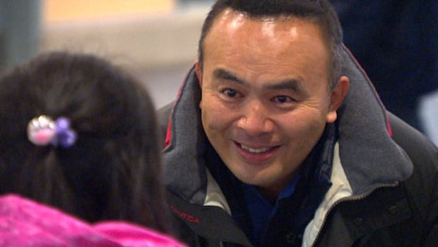 Lyndon Chen sees his daughter for the first time in five years at Vancouver International Airport on Jan. 26, 2017.