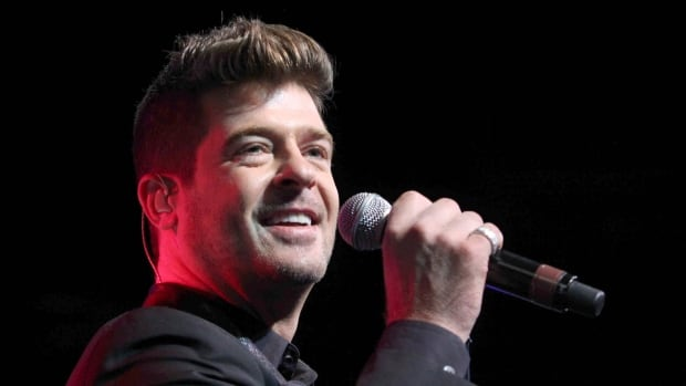 A judge has ordered singer Robin Thicke, seen performing in 2015, to stay away from his ex-wife, actress Paula Patton, and only have monitored visits with their six-year-old son.
