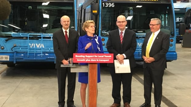 Ontario Premier Kathleen Wynne announces her government will double the amount of money the province gives to local transit agencies from the gas tax. She is flanked by, from left: Reza Moridi, MPP for Richmond Hill, Transportation Minister Steven Del Duca and Chris Ballard, MPP for Newmarket-Aurora.