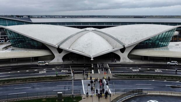 Authorities say a woman was attacked at the John F. Kennedy airport on Wednesday.