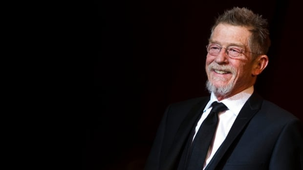 British actor John Hurt arrives on stage at the 62th Berlin International Film Festival in February 2012. Hurt has died at 77.