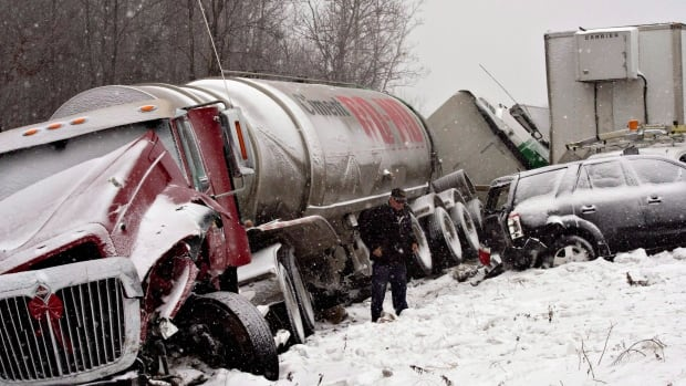 A truck driver walks away from a pile-up involving 35 vehicles in 2012. Patrick Forgues is making more resources available for truckers dealing with PTSD.