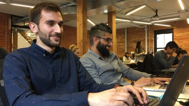 27-year-old Umar Khan works to learn the ins and outs of JavaScript as part of a ten week web development boot camp at Brainstation in downtown Toronto. He's part of a growing number of people turning to boot camps for an ultra-compact digital education.