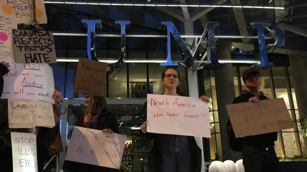A small group of people in front of the Trump Tower in downtown Vancouver protested against a ban on people entering the U.S. from some Muslim-majority countries.