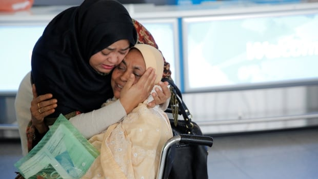 A woman greets her mother after she arrived from Dubai on Emirates Flight 203 at John F. Kennedy International Airport in Queens, New York, U.S., January 28, 2017.