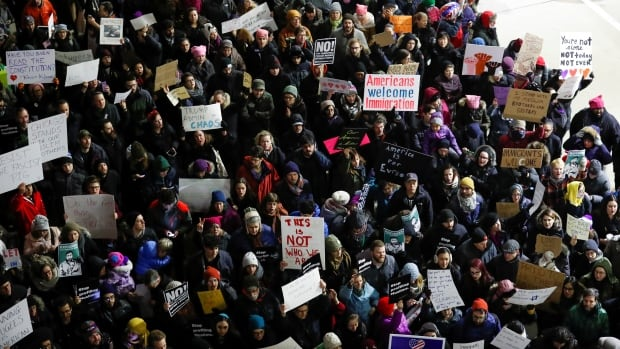 People gather at O'Hare airport in Chicago to protest against the refugee ban and travel restrictions imposed by U.S. President Donald Trump.
