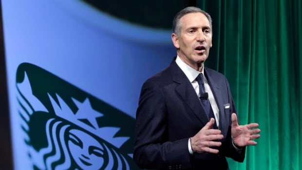 In this Dec. 7, 2016, file photo, Starbucks Chairman and CEO Howard Schultz speaks during the Starbucks 2016 Investor Day meeting in New York. Schultz said the hiring of refugees would apply worldwide and that within the U.S. recruiting would be prioritize those who have helped serve the U.S. military.