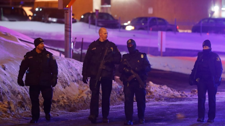 Police officers patrol the perimeter near a mosque after a shooting in Quebec City, January 29, 2017.