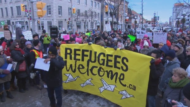 People gathered outside the U.S. Embassy in Ottawa Monday afternoon to protest an executive order signed by President Donald Trump banning citizens of seven Muslim-majority countries from entering the United States.