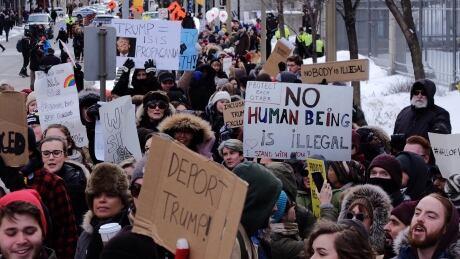 U.S. Embassy Trump protest travel ban crowd hundreds Sussex Drive Jan 30 2017