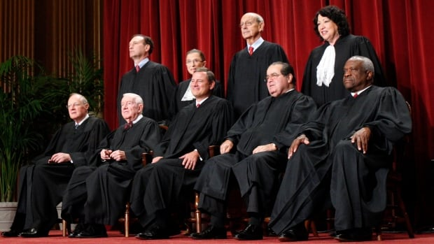 U.S. Supreme Court Justices gather for an official picture at the Supreme Court in Washington Sept. 29, 2009. They are (front row, left to right): Anthony M. Kennedy, John Paul Stevens, Chief Justice John Roberts, Antonin Scalia, Clarence Thomas; (second row, left to right) Samuel Alito, Ruth Bader Ginsburg, Stephen G. Breyer, and Sonia Sotomayor.