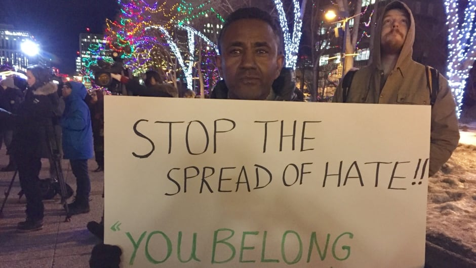 A sign at a vigil in Edmonton, in January, after the Quebec mosque shooting.