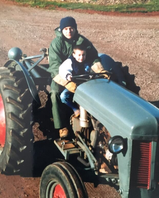 Eric and son on lawn tractor