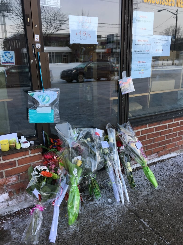 Quebec citys close knit muslim community reeling as mosque victims friends and family of azzeddine soufiane placed bouquets of flowers in front of his halal butcher shop boucherie assalam tuesday izmirmasajfo