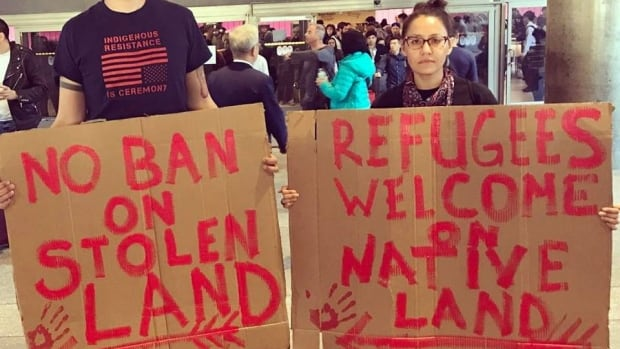 Nick Estes and Melanie Yazzie joined protests against the U.S. travel ban at the Los Angeles International Airport this past weekend.
