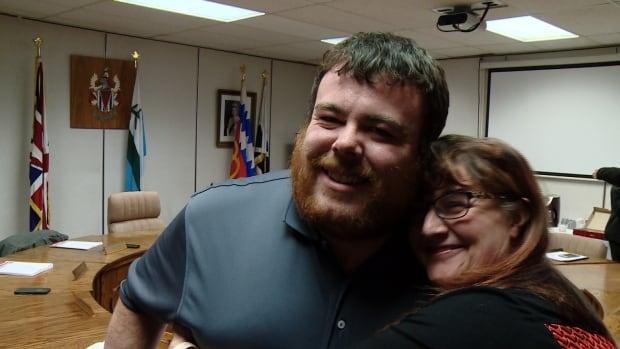 Wabush Mayor Colin Vardy and Labrador City Mayor Karen Oldford hug after the two councils approved a feasibility study for amalgamation in February.