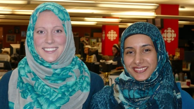 Molly Dunbar (left) isn't Muslim but donned a green and grey floral hijab Wednesday with the blessing of the CBC's Nadia Kidwai, who is Muslim, in support of Muslim women on World Hijab Day.