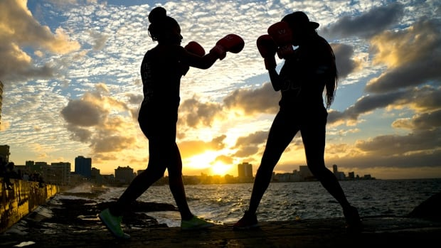 Idamelys Moreno, left, and Legnis Cala are part of a group of up-and-coming female boxers on the island who want government support to form Cuba's first female boxing team.