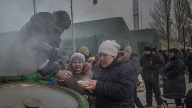 Residents of Avdiivka in eastern Ukraine receive hot soup after another brutal night of attacks.