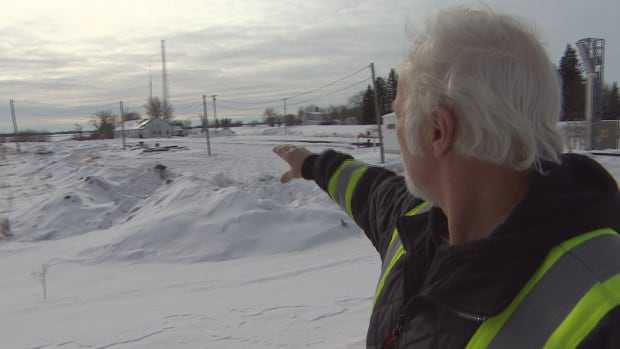 Emerson resident Frank Suderman points to the U.S. border. Many refugees cross into Canada near the Manitoba town.