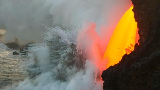 Lava spews into the ocean from the Kilauea Volcano on the Big Island of Hawaii.