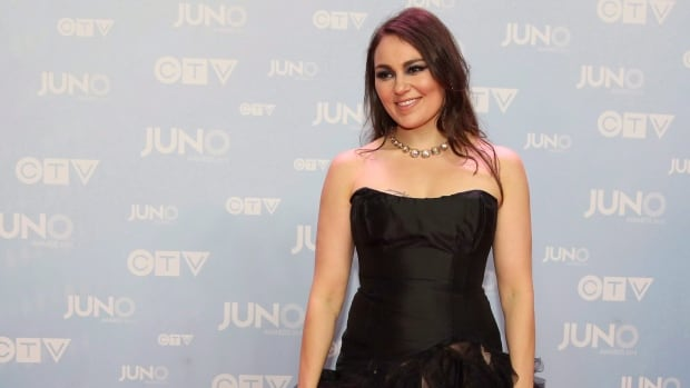 Tanya Tagaq says her Facebook account was blocked after she shared a friend's photo of a young man wearing a sealskin coat, but has since been restored.