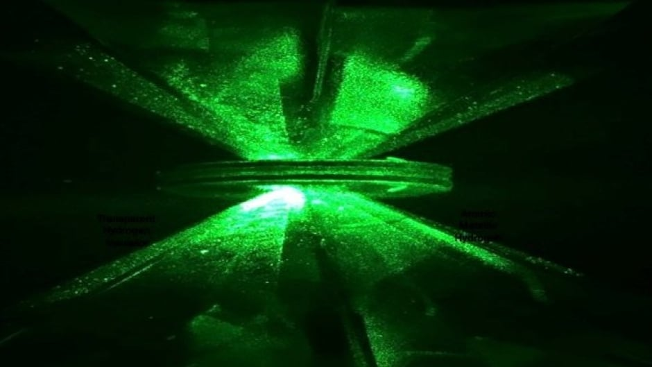 You're looking at two diamonds with a gasket, illuminated with green laser light. This is the apparatus used to squeeze hydrogen to ultra-high pressures. The hydrogen was transformed into metallic hydrogen, according to Harvard scientists.
