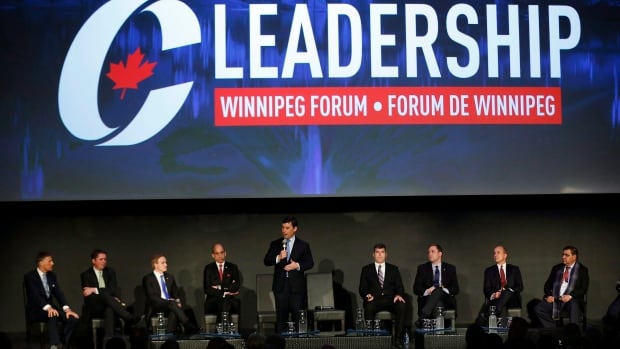 From left Maxime Bernier, Andrew Scheer, Andrew Saxton, Steven Blaney, Pierre Lemieux, Brad Trost, Rick Peterson and Deepak Obhrai listen in as Michael Chong speaks at a Conservative Party of Canada leadership forum in Winnipeg, Thursday, January 19, 2017.